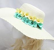 chapéu de sol à beira-mar da mulher com amarelo flor luz verde